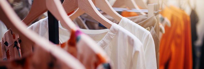 A garment rack with hanging clothes